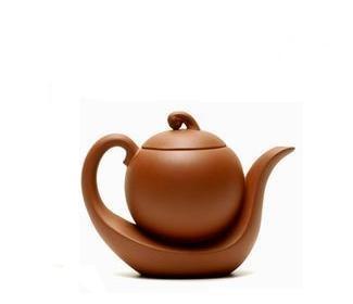 Dekorativ tekanne med kinesisk grønn te